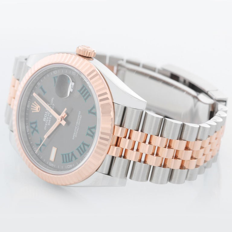 Rolex Datejust II  Men's 2-Tone Steel & Rose Gold 41mm Watch 126331 - Automatic winding, Quickset, sapphire crystal. Stainless steel case with 18k rose gold fluted bezel  (41mm diameter). Grey dial with green Roman  numerals; Wimbledon dial.