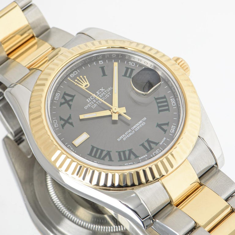 A 41mm Datejust II in Oyster steel and yellow gold by Rolex, featuring a Wimbledon dial and a fluted yellow gold bezel. The Oyster bracelet comes with a folding Oyster clasp. Fitted with scratch-resistant sapphire crystal and a self-winding