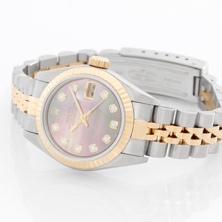 Rolex  Datejust Ladies 2-Tone Mother of Pearl Diamond Dial 79173 - Automatic winding, Quickset, 31 jewels, sapphire crystal. Stainless steel case with 18k yellow gold fluted bezel ( 26 mm ). Factory Tahitian Mother of Pearl with Diamond hour