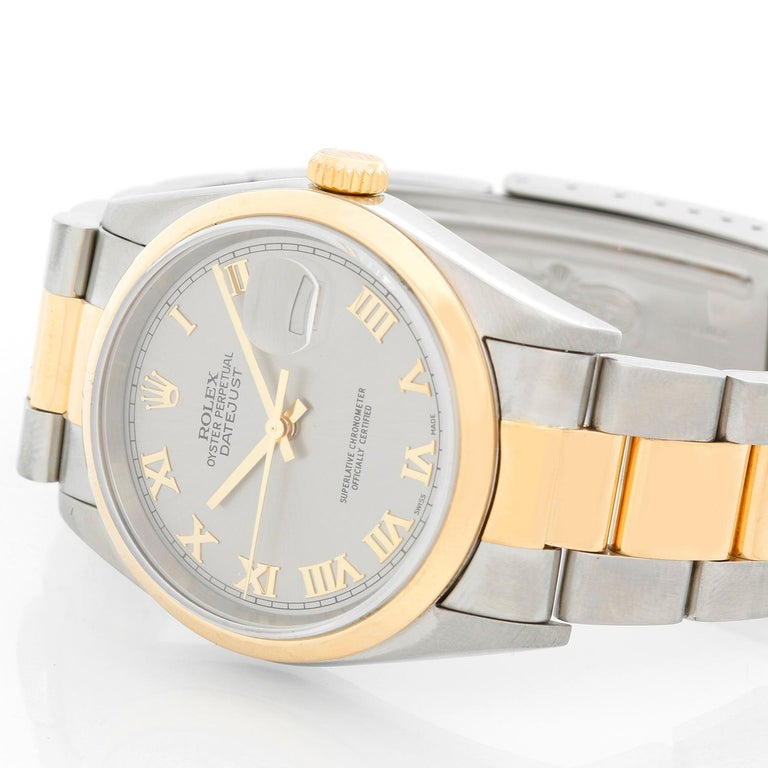 Rolex Datejust Men's 2-Tone Steel & Gold Watch 16203 - Automatic winding, 31 jewels, Quickset, sapphire crystal. Stainless steel with 18k yellow gold smooth bezel (36mm diameter). Silver dial with Roman numerals. Rolex Two- tone Oyster bracelet.