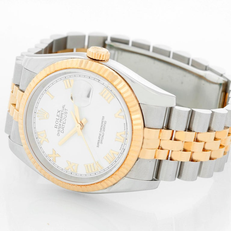 Rolex Datejust Men's 2-Tone Watch 116233 - Automatic winding, 31 jewels, Quickset, sapphire crystal. Stainless steel case with 18k yellow gold fluted bezel (36mm diameter). White dial with Roman numerals . Stainless steel and 18k yellow gold Jubilee