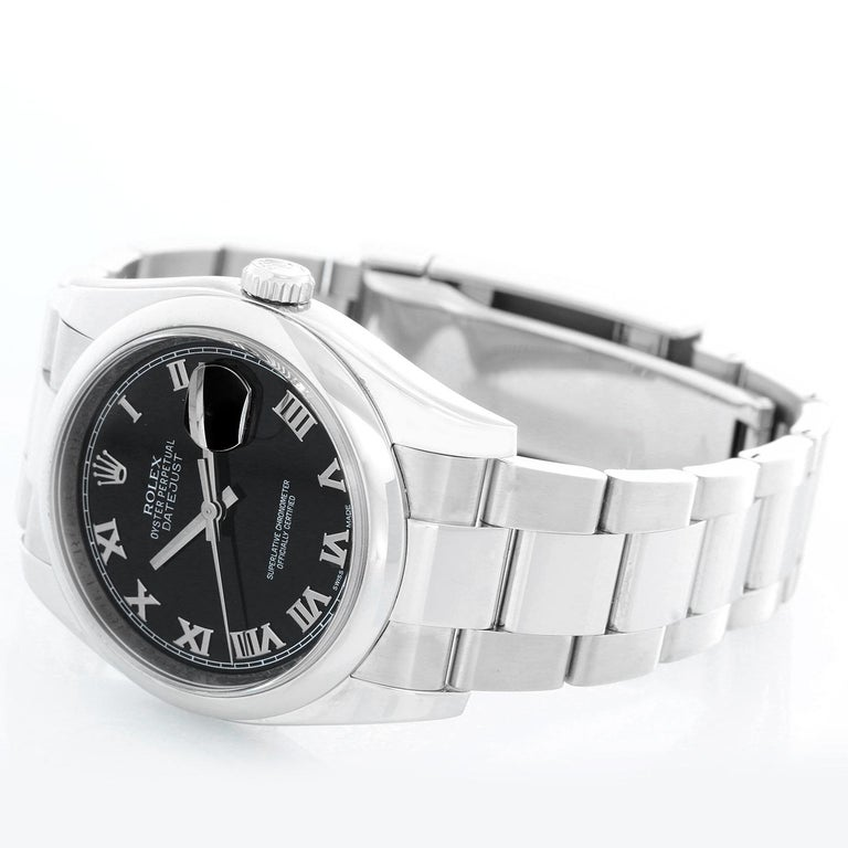 Rolex Datejust Men's Stainless Steel Automatic Winding Watch 116200 - Automatic winding, 31 jewels, Quickset, sapphire crystal. Stainless steel case with smooth bezel (36mm diameter). Black dial with Roman numerals. Stainless steel Oyster bracelet.