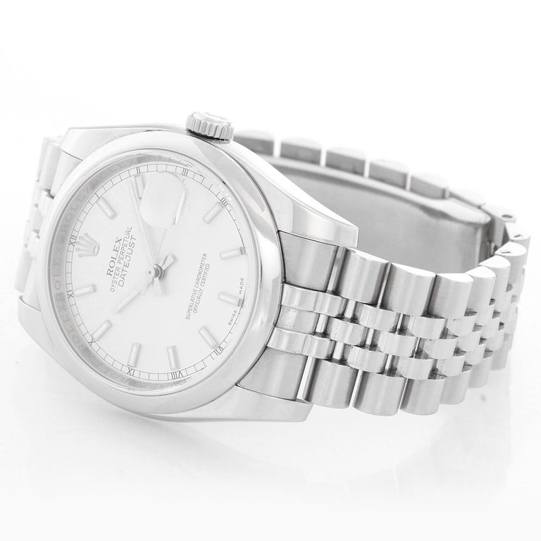 Rolex Datejust Men's Stainless Steel Automatic Winding Watch 116200 - Automatic winding, Quickset, sapphire crystal. Stainless steel case with smooth bezel (36mm diameter). Silver dial with stick hour markers. Stainless steel Jubilee bracelet.