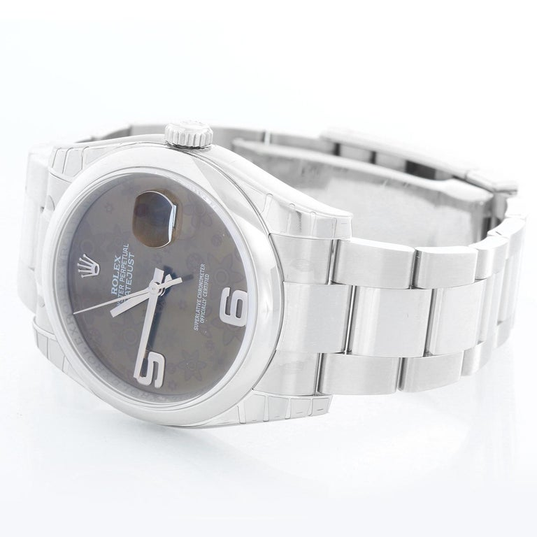 Rolex Datejust Men's Stainless Steel Watch 116200 - Automatic winding, 31 jewels, Quickset, sapphire crystal. Stainless steel case with 18k white smooth bezel. Flower dial with Roman numerals at 3, 6, 9 o'clock. Stainless steel hidden-clasp Jubilee