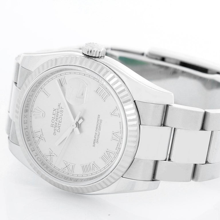 Rolex Datejust Men's Stainless Steel Watch 116234 - Automatic winding, 31 jewels, Quickset, sapphire crystal. Stainless steel case with 18k white gold fluted bezel ( 36 mm) . Silver dial with Roman numerals. Stainless steel Jubilee bracelet.