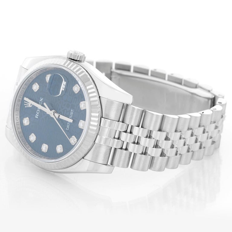 Rolex Datejust Men's Stainless Steel Watch 116234 - Automatic winding, 31 jewels, Quickset, sapphire crystal. Stainless steel case with 18k white gold fluted bezel . Blue jubilee dial with diamonds . Stainless steel hidden-clasp Jubilee bracelet