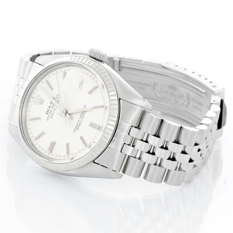 Rolex Datejust Men's Stainless Steel Watch 16014 - Automatic winding, 27 jewels, Quickset, acrylic crystal. Stainless steel with white gold fluted bezel . (36 mm ) Silver dial with stick hour markers. Stainless steel Jubilee bracelet. Pre-owned with