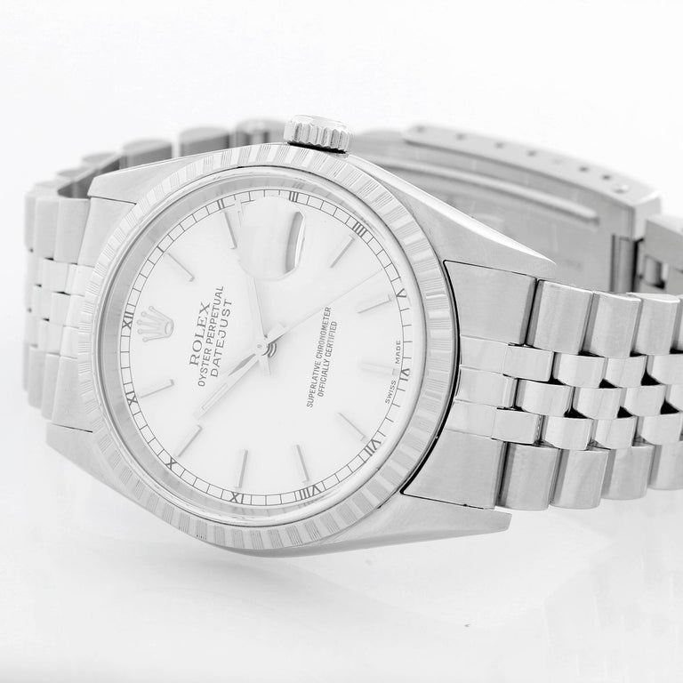 Rolex Datejust Men's Stainless Steel Watch 16220 - Automatic winding, 31 jewels, Quickset, sapphire crystal. Stainless steel case with engine turned bezel (36mm diameter). White dial with stick hour markers. Stainless steel Jubilee bracelet.