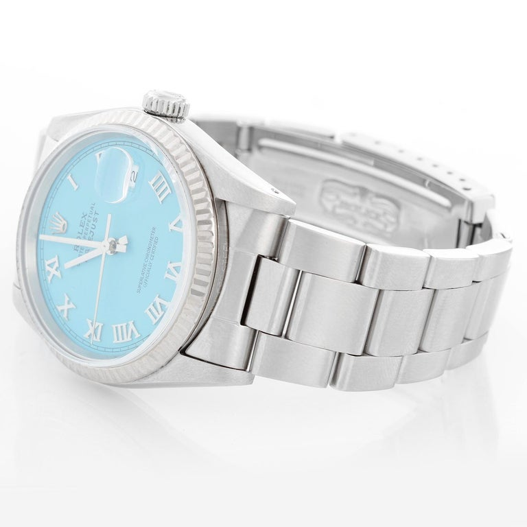 Rolex Datejust Men's Stainless Steel Watch 16234 - Automatic winding. Stainless steel case with 18k white gold fluted bezel . Custom Tiffany Blue dial Roman numeral. Stainless steel oyster bracelet. Pre-owned with custom box.