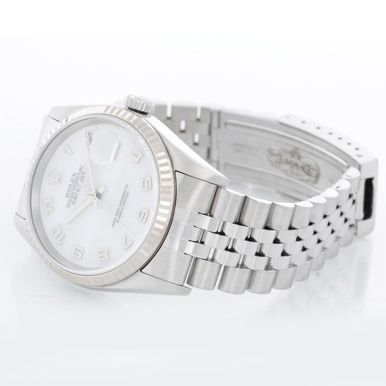 Rolex Datejust Men's Stainless Steel Watch 16234 - Automatic winding. Stainless steel case with 18k white gold fluted bezel . Factory Mother of Pearl dial . Stainless steel jubilee bracelet . Pre-owned with custom box.
