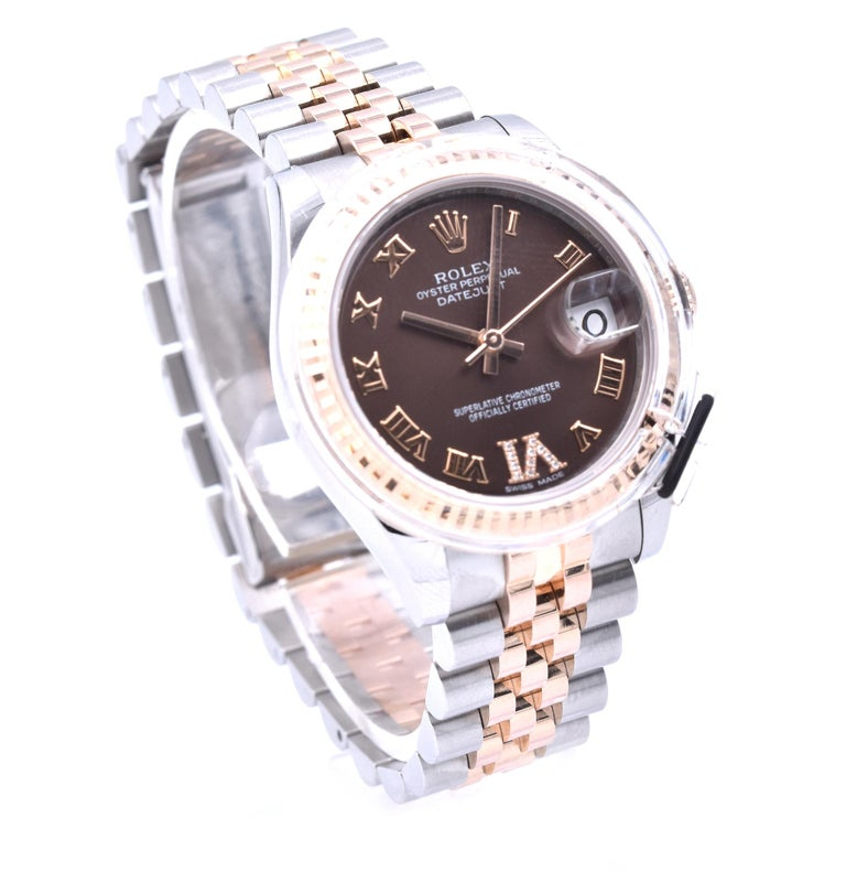 Movement: automatic movement Function: hours, minutes, seconds, date Case: round 31mm stainless steel and 18K rose gold case with fluted 18k rose gold bezel, inner reflector ring engraved with serial number, sapphire crystal, screw-down crown, water