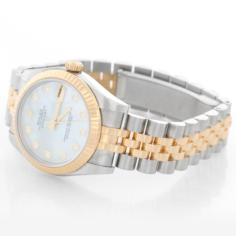 Rolex Datejust Midsize 2-Tone Watch 178273 - Automatic winding; 31 jewel; sapphire crystal. Stainless steel case with 18k yellow gold fluted bezel  (31mm diameter). Factory Mother of Pearl dial with diamond hour markers. Stainless steel and gold