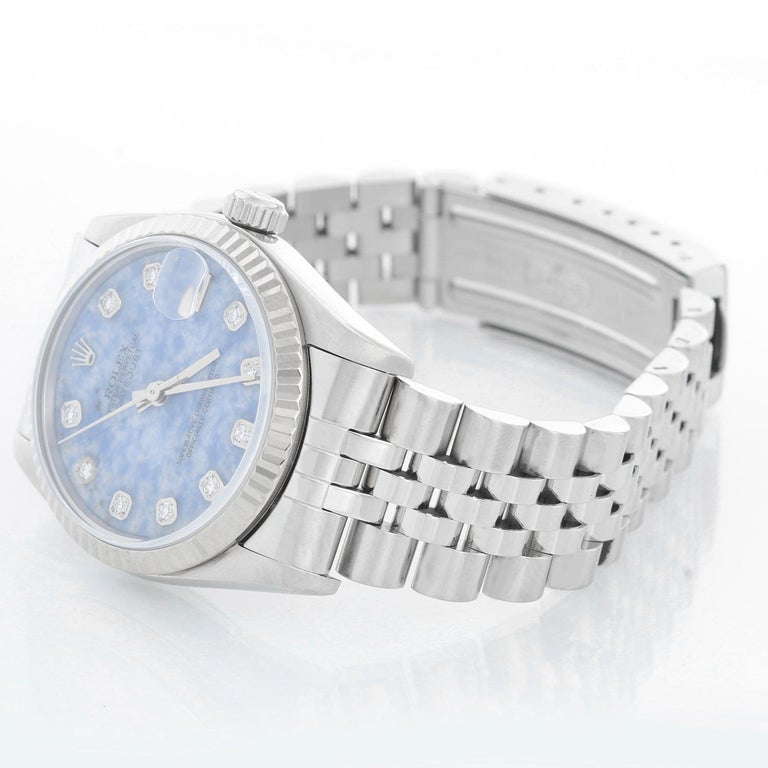 Rolex Datejust Midsize Men's or Ladies Steel Watch 68274 - Automatic winding, 29 jewels, Quickset date, sapphire crystal. Stainless steel case (31 mm ) . Factory Sodelite diamond dial. Stainless steel Jubilee Bracelet. Pre-owned with custom box.
