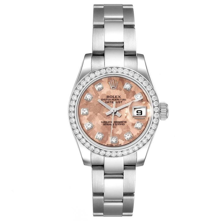 Rolex Datejust Steel Pink Gold Crystal Diamond Ladies Watch 179384 Box Card. Officially certified chronometer self-winding movement. Stainless steel oyster case 26.0 mm in diameter. Rolex logo on a crown. Original Rolex factory diamond bezel.