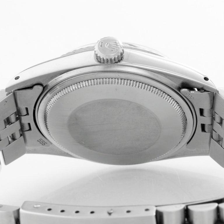 Rolex Datejust Steel Watch 1601 Orange Dial Mens Watch - Automatic winding, acrylic crystal. Stainless steel case with steel bezel (36mm diameter). Orange dial with stick hour makers. Stainless steel Jubilee bracelet. Pre-owned with custom box.