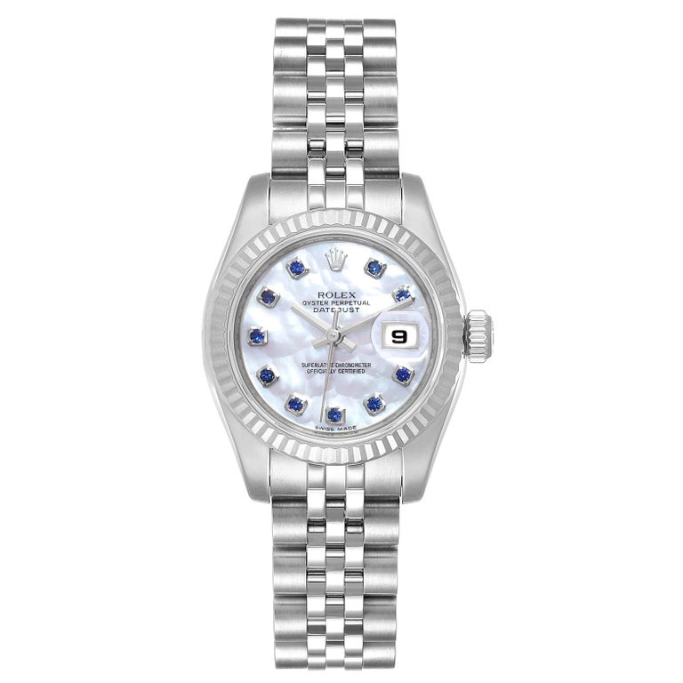 Rolex Datejust Steel White Gold MOP Saphire Ladies Watch 179174 Box Card. Officially certified chronometer self-winding movement. Stainless steel oyster case 26.0 mm in diameter. Rolex logo on a crown. 18K white gold fluted bezel. Scratch resistant