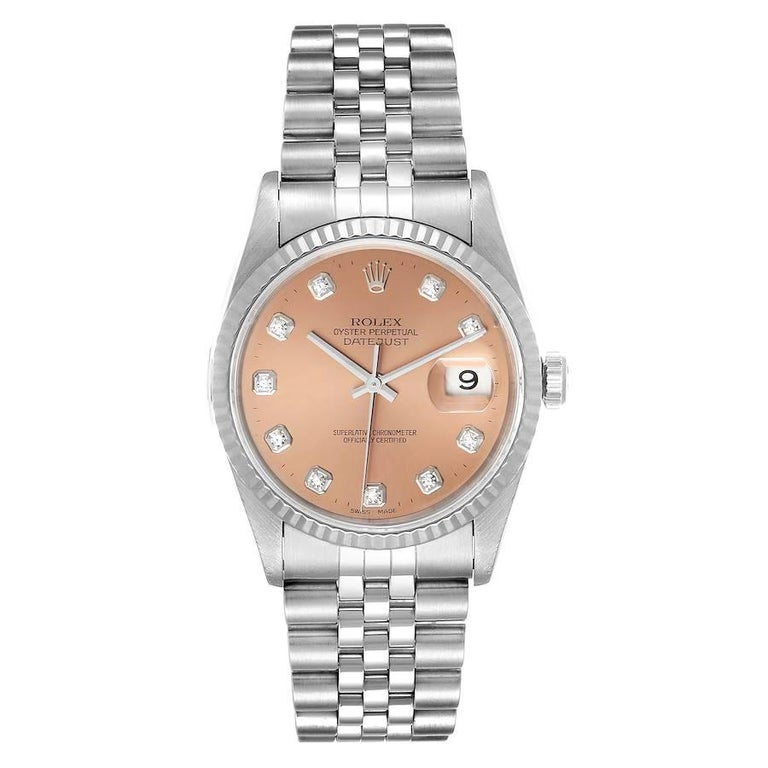 Rolex Datejust Steel White Gold Salmon Diamond Dial Mens Watch 16234. Officially certified chronometer self-winding movement. Stainless steel oyster case 36.0 mm in diameter. Rolex logo on a crown. 18k white gold fluted bezel. Scratch resistant