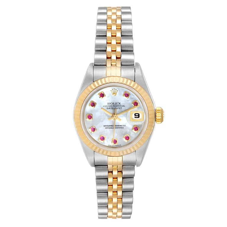 Rolex Datejust Steel Yellow Gold MOP Ruby Ladies Watch 79173 Box Papers. Officially certified chronometer self-winding movement. Stainless steel oyster case 26.0 mm in diameter. Rolex logo on a crown. 18k yellow gold fluted bezel. Scratch resistant