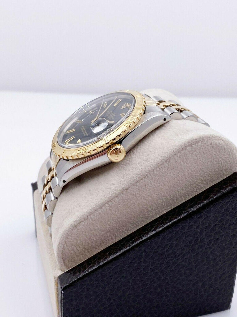 Style Number: 16253      Serial: R810***     Model: Datejust Thunderbird     Case Material: Stainless Steel     Band: 18K Yellow Gold & Stainless Steel     Bezel:  18K Yellow Gold     Dial: Black     Face: Acrylic     Case Size: 36mm     Includes: