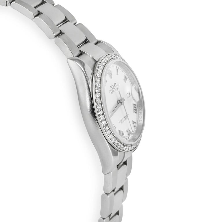 Rolex Pre-owned Ladies' Datejust White Gold & Diamonds Stainless steel case 18K white gold & diamond bezel Reference Number:  116244 Self-winding mechanical movement, Rolex caliber 3135 Scratch resistant sapphire crystal with Cyclops lens over the