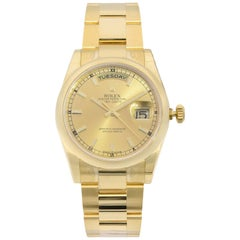 Rolex Day-Date 18 Karat Yellow Gold Champagne Dial Automatic Men's Watch 118208