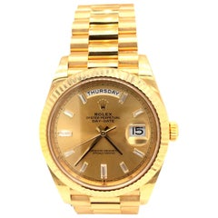 Rolex Day-Date 18K Yellow Gold Men's President Motif Black Dial Watch 228238
