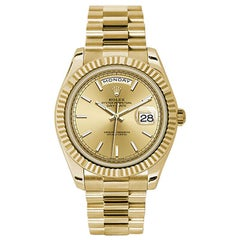 Rolex Day-Date 228238 18 Karat Yellow Gold Champagne Dial Automatic Men's Watch