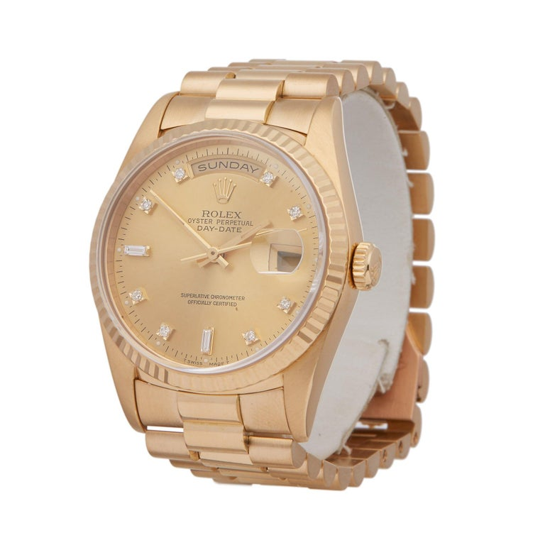 Xupes Reference: W007208 Manufacturer: Rolex Model: Day-Date Model Variant: 36 Model Number: 18238 Age: 1996 Gender: Men Complete With: Rolex Box & Manuals Dial: Champagne Diamond Glass: Sapphire Crystal Case Size: 36mm Case Material: Yellow
