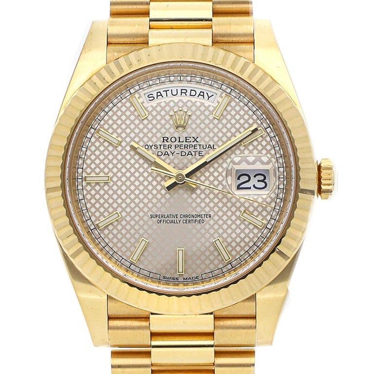 This brand new Rolex Day-Date 40 228238 sdmip is a beautiful men's timepiece that is powered by an automatic movement which is cased in a yellow gold case. It has a round shape face, day & date dial and has hand sticks style markers. It is completed