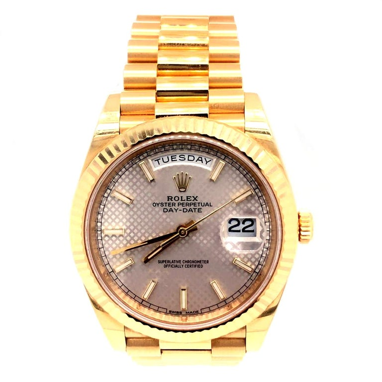 Setting a new standard in luxury timepieces by adding a silver-toned dial with yellow gold components Rolex redesigned Oyster Perpetual Day-Date 40 for those with expensive tastes. The 228238 has a 40 mm case with a monobloc middle case, screw-down