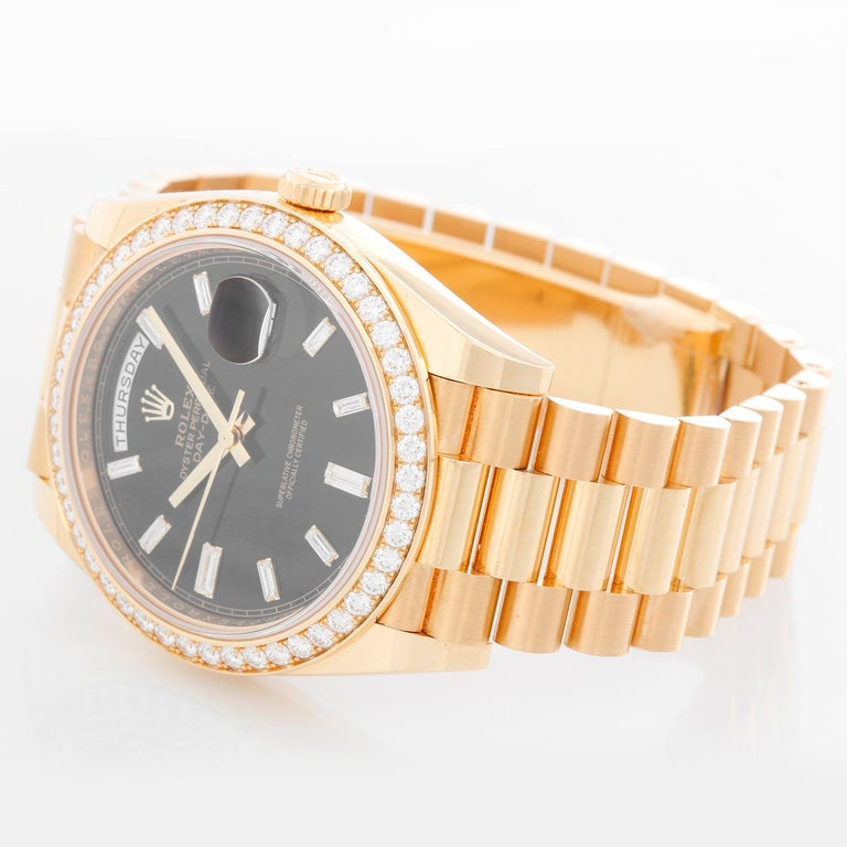 Rolex Day-Date II President 18k Yellow Gold Men's 40mm Watch 2282348 RBR - Automatic winding, 31 jewels, sapphire crystal, with day and date. 18K Yellow gold; diamond bezel  (40mm diameter). Black dial with baguette hour markers.. 18k yellow gold