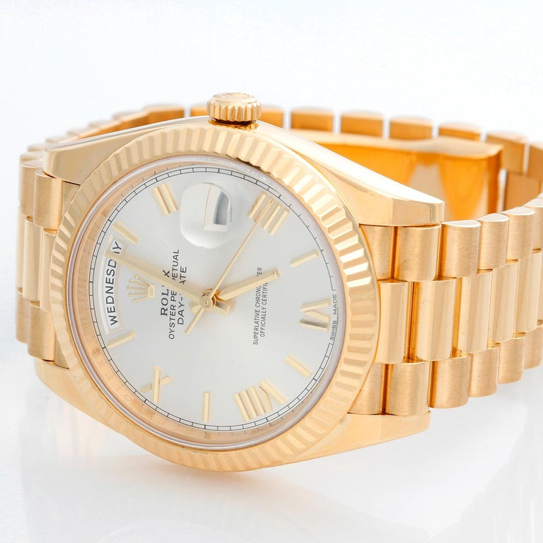 Rolex Day-Date II President 18k Yellow Gold Men's 40mm Watch 228238 - Automatic winding, 31 jewels, sapphire crystal, with day and date. 18K Yellow gold; fluted bezel  (40mm diameter). Black dial with baguette  hour markers. 18k yellow gold