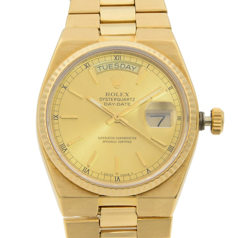 This pre-owned Rolex Day-Date Oysterquartz 19018 is a beautiful men's timepiece that is powered by quartz (battery) movement which is cased in a yellow gold case. It has a tonneau shape face, day & date dial and has hand sticks style markers. It is