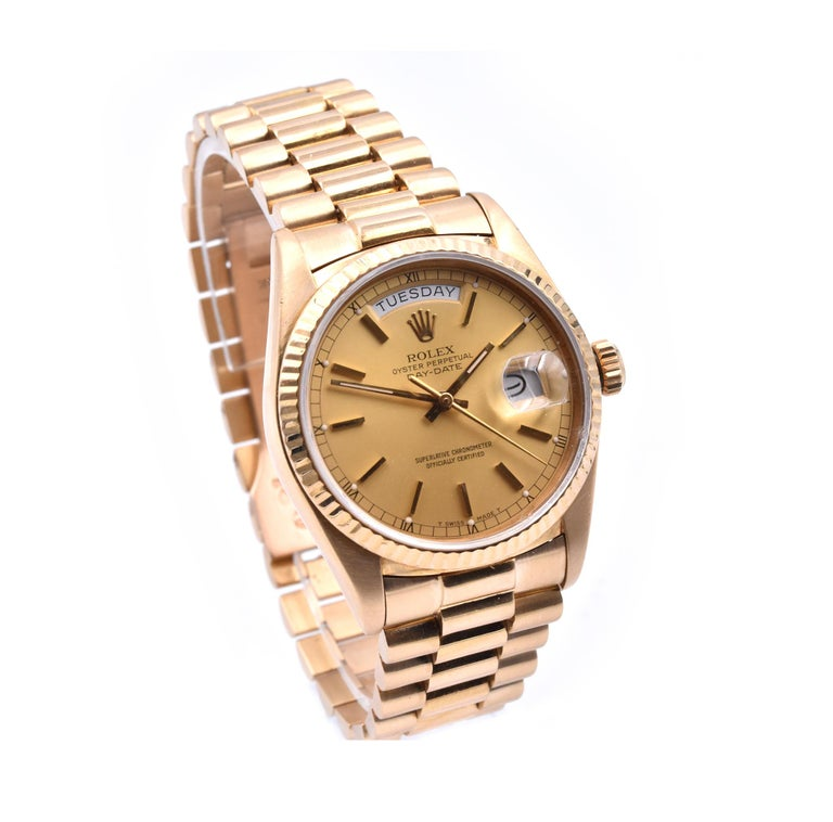Brand: Rolex Movement: automatic Function: seconds, minutes, hours, day, date Case: 36mm 18k yellow gold case, fluted bezel, scratch resistant sapphire crystal Band: 18k yellow gold Rolex President bracelet Dial: factory champagne dial with gold