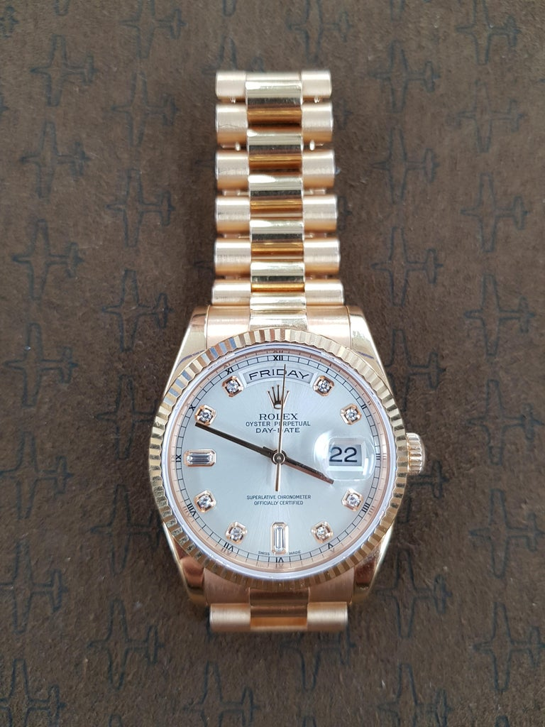 This 36mm dial, rose gold, Rolex Day Date comes with full Rolex certification.  It has been fitted with new (Rolex manufactured) links and it contains a solid clasp.