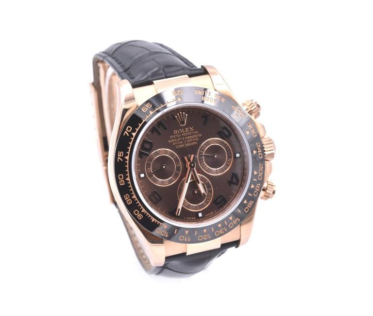 Movement: automatic 4130 caliber movement Function: hours, minutes, seconds, date, chronograph, tachymeter Case: 40mm 18k Everose gold case, 18k rose gold crown and pushers, sapphire protective crystal Band: Rolex black alligator strap w/ 18k