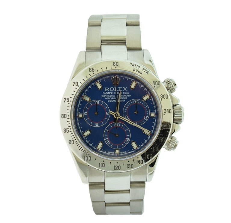 Brand: Rolex  Model Name: Daytona  Model Number: 116520  Movement: Automatic  Case Size: 40 mm  Case Material: Stainless Steel   Dial: Blue Dial (After market)  Bezel: Engraved Tachymetric Scale  Hour Markers: Stick Hour Markers  Bracelet: Stainless