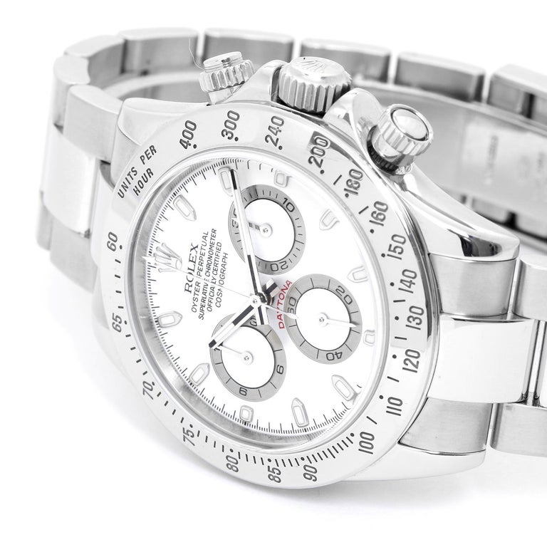 Rolex Daytona Men's Chronograph Watch 116520 - Automatic winding, chronograph, 44 jewels, sapphire crystal. Stainless steel case (40mm diameter). White dial with luminous hour markers. Stainless steel Oyster bracelet with flip-lock clasp. Pre-owned