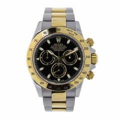 Rolex Daytona Stainless Steel and 18 Karat Yellow Gold Black Dial Watch 116523