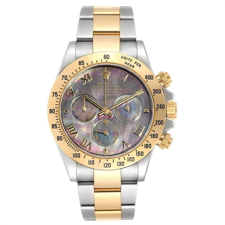 Rolex Daytona Steel Yellow Gold Black Mother of Pearl Dial Chronograph Mens Watch 116523. Officially certified chronometer self-winding movement. Rhodium-plated, oeil-de-perdrix decoration, straight line lever escapement, monometallic balance