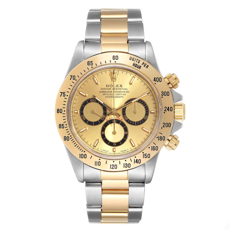 Rolex Daytona Steel Yellow Gold Mens Watch 16523 Box. Officially certified chronometer self-winding movement. Stainless steel and 18K yellow gold case 40 mm in diameter. Special screw-down push buttons. 18K yellow gold tachymeter engraved bezel.