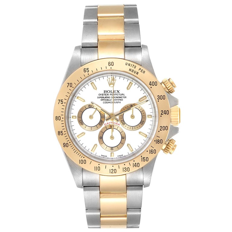 Rolex Daytona Steel Yellow Gold White Dial Chronograph Mens Watch 116523. Officially certified chronometer self-winding movement. Rhodium-plated, oeil-de-perdrix decoration, straight line lever escapement, monometallic balance adjusted to 5