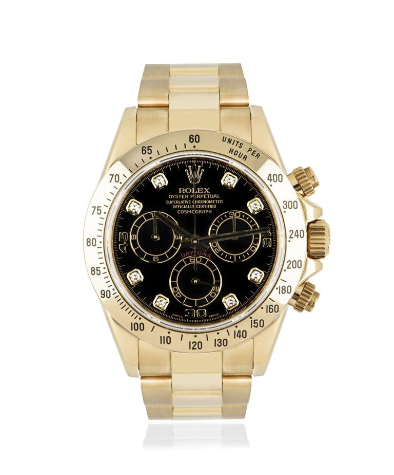 A 40mm Daytona in yellow gold by Rolex, with a black dial that's set with 8 round brilliant cut diamond hour markers. Featuring a tachymetric scale, three counters and pushers, specially designed to be the ultimate timing tool for endurance racing