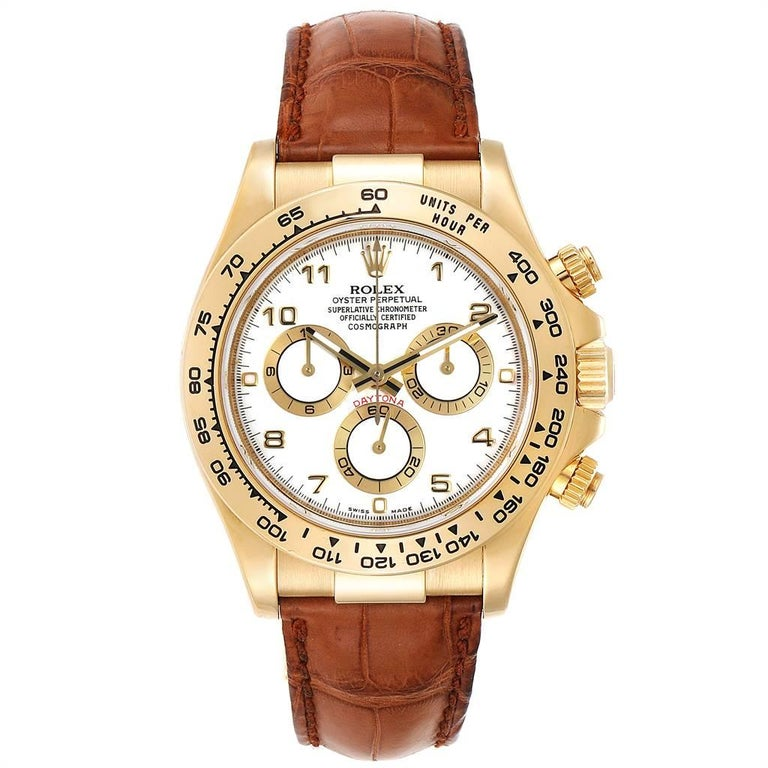 Rolex Daytona Yellow Gold White Dial Brown Strap Mens Watch 116518. Officially certified chronometer automatic self-winding movement. Chronograph function. 18K yellow gold case 40.0 mm in diameter.  Special screw-down push buttons. 18K yellow gold