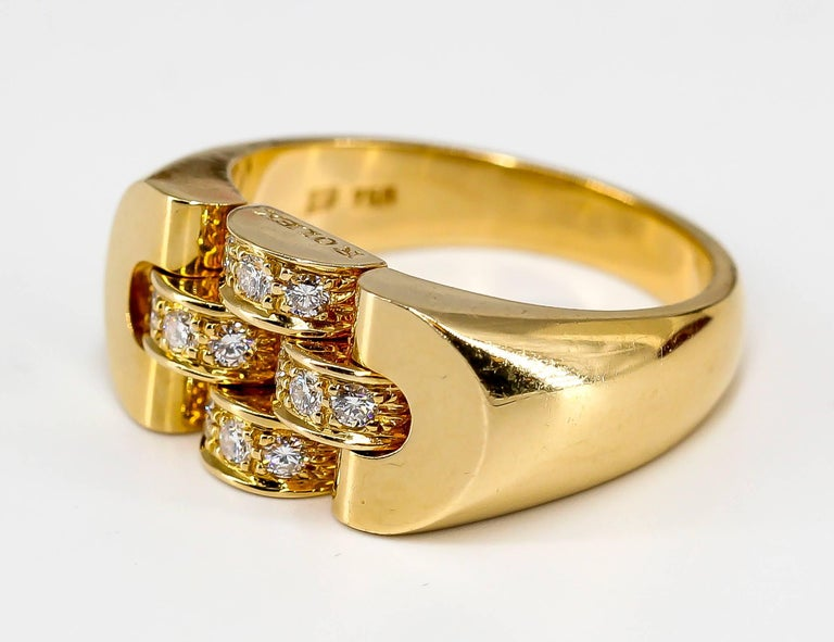 Cool diamond and 18K yellow gold ring by Rolex. It features high grade round brilliant cut diamonds Currently size 9 but can be sized slightly up and down.   Hallmarks: Rolex, 750, maker's mark.