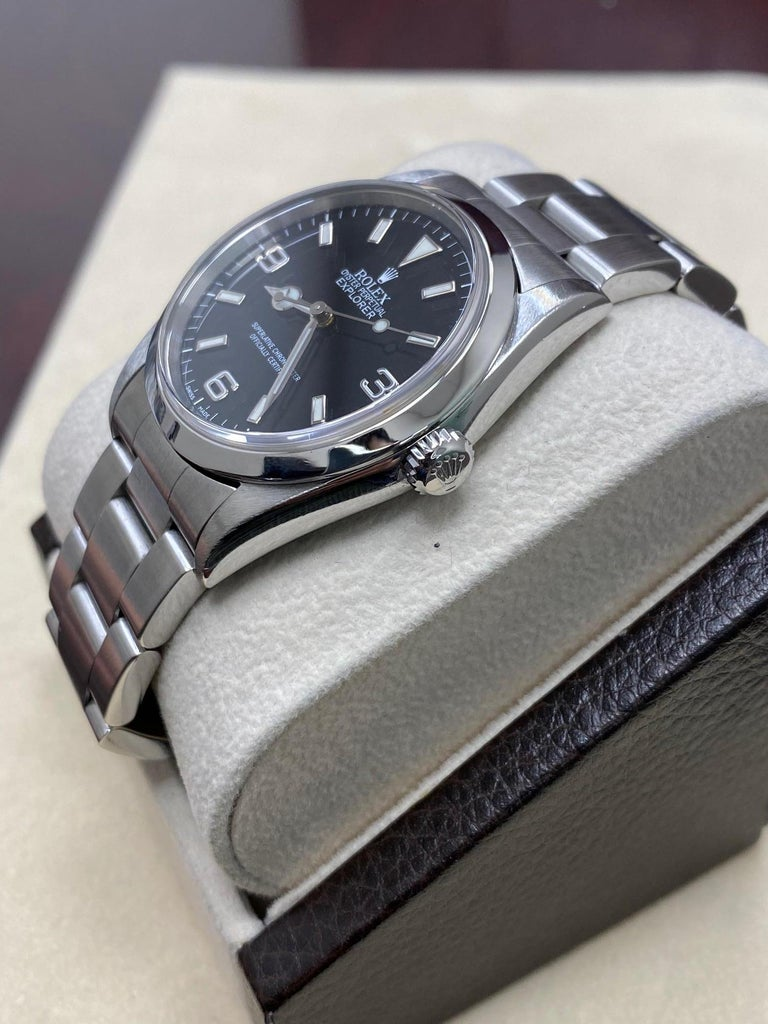 Style Number: 14270   Serial: P684***  Year: 2001   Model: Explorer    Case Material: Stainless Steel   Band: Stainless Steel   Bezel:  Stainless Steel   Dial: Black   Face: Sapphire Crystal   Case Size: 36mm   Includes:  -Elegant Watch