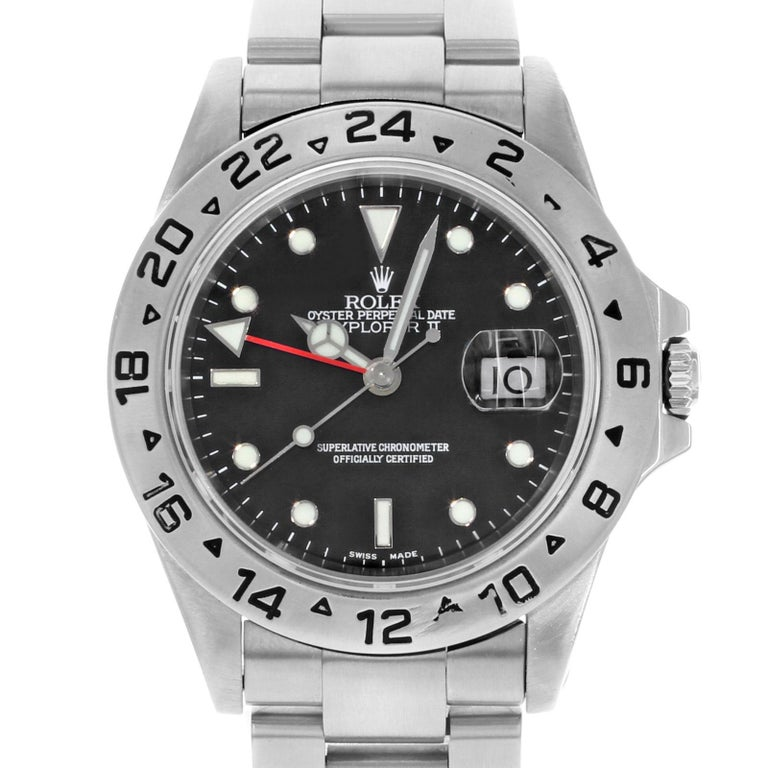 (27818) This pre-owned Rolex Explorer II 16570 is a beautiful men's timepiece that is powered by an automatic movement which is cased in a stainless steel case. It has a round shape face, date dial and has hand sticks & dots style markers. It is