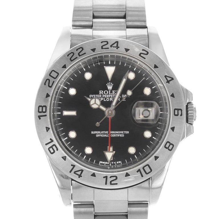 (20789) This pre-owned Rolex Explorer II 16570 is a beautiful men's timepiece that is powered by an automatic movement which is cased in a stainless steel case. It has a round shape face, date, dual time dial and has hand sticks & dots style