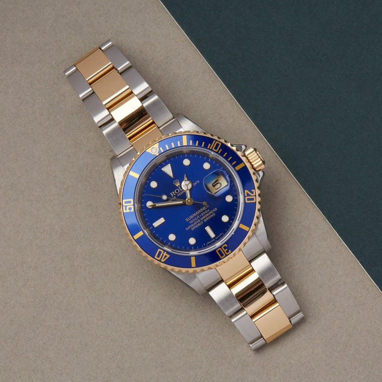 Xupes Reference: W007646 Manufacturer: Rolex Model: Submariner Model Variant: Date Model Number: 16613 Age: 2006 Gender: Men Complete With: Rolex Box, Manuals, Guarantee, Card Holder & Swing Tag Dial: Blue Other Glass: Sapphire Crystal Case Size: