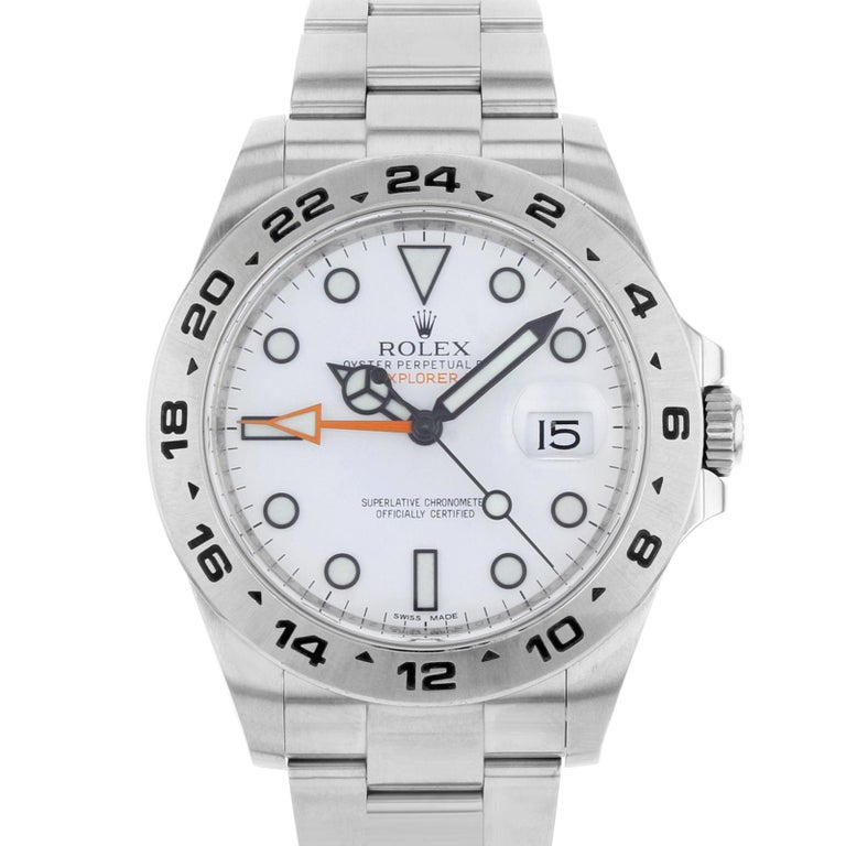 (20049) This pre-owned Rolex Explorer II 216570 is a beautiful men's timepiece that is powered by an automatic movement which is cased in a stainless steel case. It has a round shape face, date dial and has hand sticks & dots style markers. It is